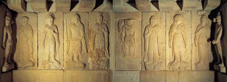 A group of guardian deities in bas relief decorates the walls of the Seokguram Grotto antechamber.