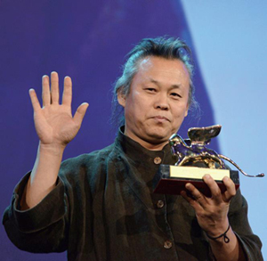 Korean movie director Kim Ki-duk holds the Golden Lion Award for the movie 'Pieta', during the closing award ceremony of the 69th Venice International Film Festival in Venice, Italy, 08 September 2012.